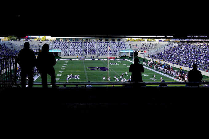 Kansas State fans watch during the second half of the team's NCAA college football game against Texas Tech on Saturday, Oct. 3, 2020, in Manhattan, Kan. Kansas State won 31-21. (AP Photo/Charlie Riedel)