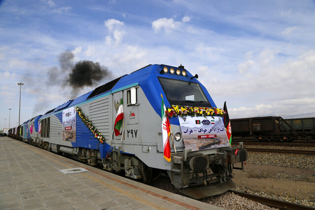 A train moves during the inauguration of a 140-kilometer (90-mile) line running from eastern Iran into western Afghanistan, at a railroad station in Khaf, Iran, Thursday, Dec. 10, 2020. The leaders of Iran and Afghanistan on Thursday inaugurated the first railway link between the two countries, expressing hope it would enhance trade links across the region. (Mohammad Ramezani, ISNA via AP)
