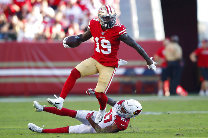San Francisco 49ers wide receiver Deebo Samuel (19) runs against Arizona Cardinals cornerback Kevin Peterson (27) during the second half of an NFL football game in Santa Clara, Calif., Sunday, Nov. 17, 2019. (AP Photo/John Hefti)