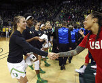 Oregon's Sabrina Ionescu, left, exchanges hats with U.S.'s Seimone Augustus before their women's exhibition basketball game in Eugene, Ore., Saturday, Nov. 9, 2019. (AP Photo/Chris Pietsch)