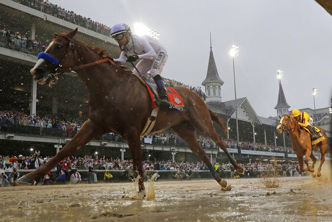 FILE - In this May 5, 2018, file photo, Mike Smith rides Justify to victory during the 144th running of the Kentucky Derby horse race at Churchill Downs in Louisville, Ky. The move of the Triple Crown's first leg to Labor Day weekend due to the coronavirus pandemic will mark the first time the Derby won't run on the first Saturday in May since 1945. (AP Photo/Morry Gash, File)