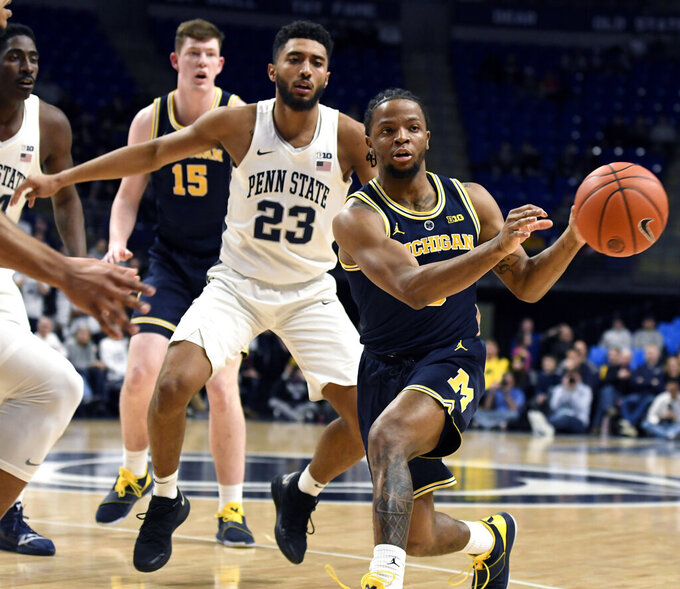 Big 10 lead at stake in 1st Michigan-Michigan St matchup