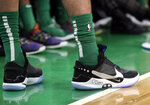 In this Feb. 7, 2019 photo, Boston Celtics forward Jayson Tatum stands at the bench area during an NBA basketball game against the Los Angeles Lakers in Boston. He is wearing Nike's latest performance basketball shoes, which from concept to reality, took about three years to put together. Or 30 years, depending on how you count. The Nike Adapt BB _ a self-lacing smart shoe that can be controlled by a smartphone _ gets released to the public on Sunday, Feb. 17, 2019, a date that just happens to coincide with the NBA All-Star Game in Charlotte. It has a motor embedded within the shoe, and a hefty $350 price tag. It has a motor embedded within the shoe, and a hefty $350 price tag. (AP Photo/Elise Amendola)
