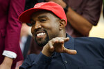Rapper Kanye West smiles as he talks with President Donald Trump during a meeting in the Oval Office of the White House, Thursday, Oct. 11, 2018, in Washington. (AP Photo/Evan Vucci)