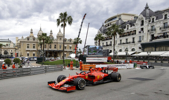 Ferrari driver Sebastian Vettel of Germany steers his car during the Monaco Formula One Grand Prix race, at the Monaco racetrack, in Monaco, Sunday, May 26, 2019. (AP Photo/Luca Bruno)