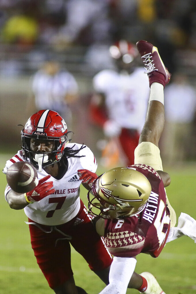 Jacksonville State cornerback Yul Gowdy (7) attempts to intercept a pass to Florida State wide receiver Keyshawn Helton (6) during the fourth quarter of an NCAA college football game Saturday, Sept. 11, 2021, in Tallahassee, Fla. The pass fell incomplete. Jacksonville State won 20-17. (AP Photo/Phil Sears)