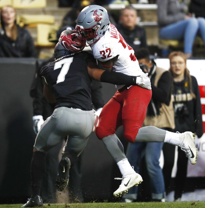 Colorado defensive back Nick Fisher, left, tackles Washington State running back James Williams after a short gain in the second half of an NCAA college football game Saturday, Nov. 10, 2018, in Boulder, Colo. Washington State won 31-7. (AP Photo/David Zalubowski)