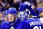 Toronto Maple Leafs centre Auston Matthews (34) and goaltender Frederik Andersen (31) celebrate after defeating the Boston Bruins in an NHL round one playoff hockey game in Toronto on Monday, April 16, 2018. (Frank Gunn/The Canadian Press via AP)