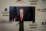 Republican U.S. Sen. Dan Sullivan shown in a monitor looks on during a debate with his major rival in Alaska's Senate race on Friday, Oct. 23, 2020, in Anchorage, Alaska. Sullivan participated in the debate against independent Al Gross remotely, as the Senate prepares to vote on President Donald Trump's Supreme Court nominee in Washington. (Jeff Chen/Alaska Public Media via AP, Pool)