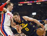 Cleveland Cavaliers' Kevin Love (0) drives to the basket against Detroit Pistons' Luke Kennard (5) in the first half of an NBA basketball game, Tuesday, Dec. 3, 2019, in Cleveland. (AP Photo/Tony Dejak)