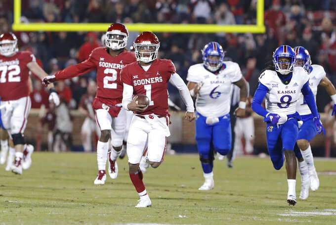 Oklahoma quarterback Kyler Murray (1) runs for a touchdown ahead of Kansas defenders during the second half of an NCAA college football game in Norman, Okla., Saturday, Nov. 17, 2018. Oklahoma won 55-40. (AP Photo/Alonzo Adams)