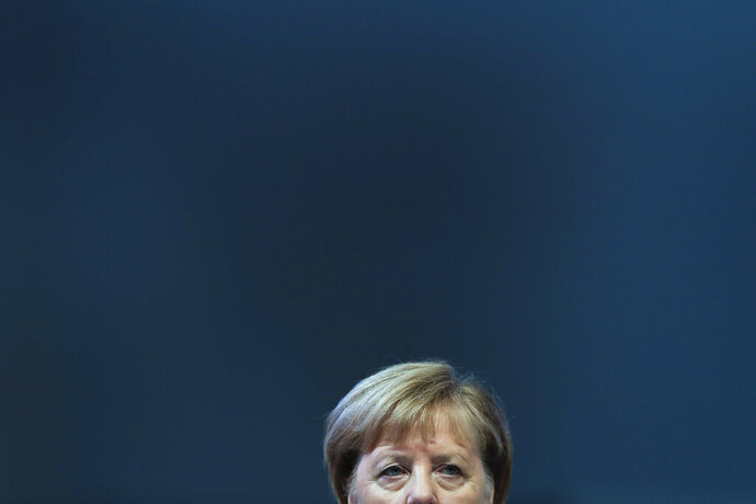 German Chancellor Angela Merkel attends a Christian Democratic Union party convention in Leipzig, Germany, Friday, Nov. 22, 2019. (AP Photo/Markus Schreiber)