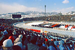 This Feb. 3, 1972, photo shows a ceremony marking the opening of the XIth Winter Olympic Games at Makomanai Ice Stadium. The city of Sapporo is the first to officially bid for the 2030 Winter Olympics and becomes the early favorite after the Japanese Olympic Committee approved its candidate file late Wednesday, Jan. 29, 2020. Sapporo was host to the 1972 Winter Olympics and could face competition from Salt Lake City in the United States, which is also being mentioned as a possible bidder, along with Barcelona and a bid tied to the Pyrenees. (Kyodo News via AP)