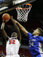 Air Force's Ryan Swan-Ford (34) defends as Fresno State's Nate Grimes shoots (32) during the second half of an NCAA college basketball game in the Mountain West Conference men's tournament Thursday, March 14, 2019, in Las Vegas. (AP Photo/Isaac Brekken)