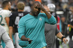 Miami Dolphins head coach Brian Flores walks off the field after losing to the Las Vegas Raiders in overtime of an NFL football game, Sunday, Sept. 26, 2021, in Las Vegas. (AP Photo/David Becker)