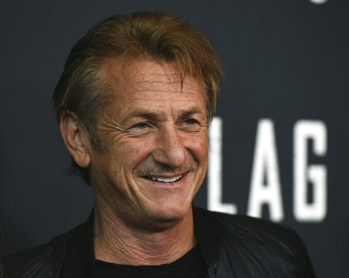 """FILE - In this Aug. 11, 2021 file photo, Sean Penn arrives at the Los Angeles premiere of """"Flag Day"""" at the Directors Guild of America Theater in Los Angeles.  A disaster relief organization founded by Penn is boosting Georgia's drive to inoculate people against the coronavirus, though some of its pop-up vaccine clinics have struggled to attract people.(Photo by Jordan Strauss/Invision/AP, File)"""