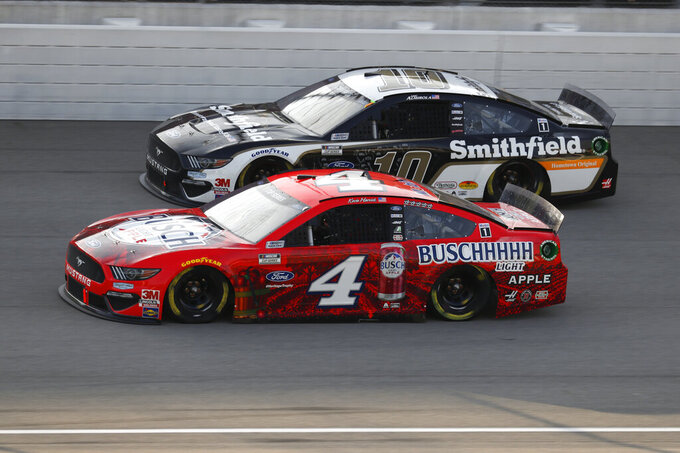 Kevin Harvick (4) races Aric Almirola (10) during the NASCAR Cup Series auto race at Michigan International Speedway in Brooklyn, Mich., Sunday, Aug. 9, 2020. (AP Photo/Paul Sancya)