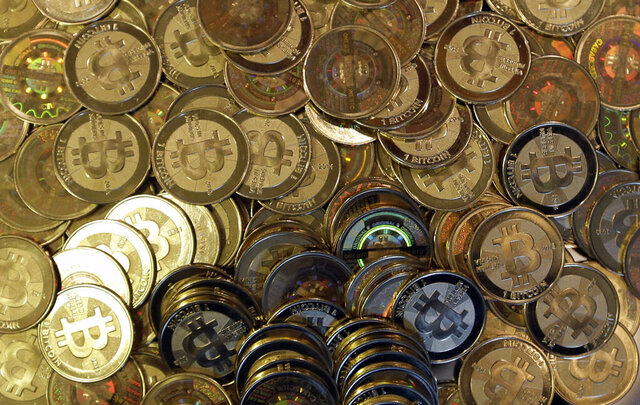 FILE - This April 3, 2013, file photo shows bitcoin tokens in Sandy, Utah. Unidentified hackers broke into the Twitter accounts of technology moguls, politicians, celebrities and major companies Wednesday, July 15, 2020, in an apparent Bitcoin scam. (AP Photo/Rick Bowmer, File)