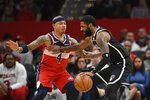 Brooklyn Nets guard Kyrie Irving, right, dribbles next to Washington Wizards guard Isaiah Thomas (4) during the first half of an NBA basketball game, Saturday, Feb. 1, 2020, in Washington. (AP Photo/Nick Wass)