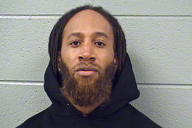 FILE - In this Feb. 13, 2019, file booking photo provided by the Cook County Sheriff's Office, is Michael Hayward in Chicago. A federal judge has ordered the former security guard at a suburban Chicago high school to pay $3 million in damages to the family of a former student who alleges that he sexually abused her dozens of times. The default judgment granted Tuesday, Sept. 8, 2020, against 35-year-old Haywood of Evanston, Ill., awards the student's family $2 million in compensatory damages and $1 million in punitive damages. (Cook County Sheriff's Office via AP, File)