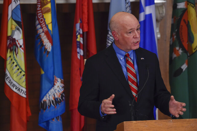 Montana Gov. Greg Gianforte speaks to members of the press in the Governor's Reception Room of the Montana State Capitol in Helena, Mont. Tuesday, Jan. 5, 2021. (Thom Bridge/Independent Record via AP)