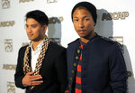 FILE - In this June 29, 2012 file photo the Neptunes, Pharrell Williams, right, poses alongside his producing partner Chad Hugo at the 25th Annual ASCAP Rhythm & Soul Music Awards in Beverly Hills, Calif. The duo among the artists who will be inducted into the Songwriters Hall of Fame on June 11, 2020, in New York City.  (Photo by Chris Pizzello/Invision/AP, File)
