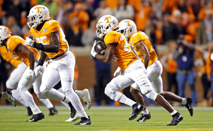 Tennessee defensive back Bryce Thompson (20) runs back an interception in the first half of an NCAA college football game against UAB, Saturday, Nov. 2, 2019, in Knoxville, Tenn. (AP Photo/Wade Payne)