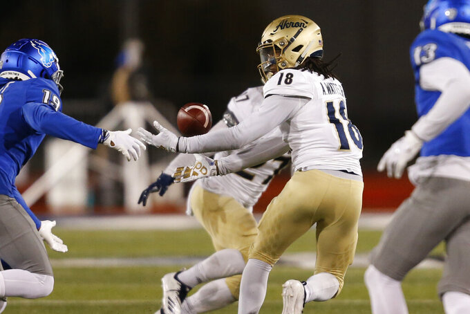 Akron's A.J. Watts (18) makes an interception during the second half of an NCAA college football game against Buffalo in Amherst, N.Y., Saturday, Dec. 12, 2020. (AP Photo/Jeffrey T. Barnes)