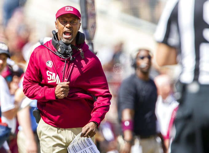FILE - In this Saturday, Oct. 27, 2018, file photo, Florida State head coach Willie Taggart disagrees with the referee during the first half of an NCAA college football game against Clemson in Tallahassee, Fla. Taggart's Seminoles are coming off a blowout home loss to No. 2 Clemson as they visit North Carolina State in Saturday. (AP Photo/Mark Wallheiser, File)