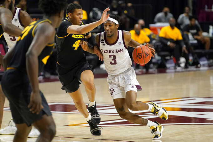 Texas A&M guard Quenton Jackson (3) drives the lane against Missouri guard Javon Pickett (4) during the second half of an NCAA college basketball game Saturday, Jan. 16, 2021, in College Station, Texas. (AP Photo/Sam Craft)