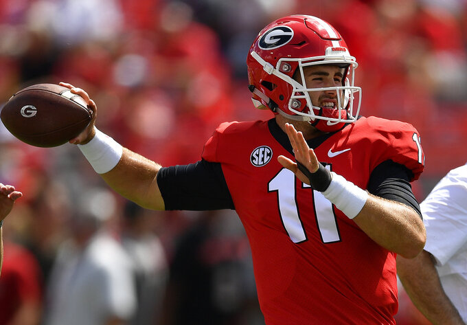 FILE - In this Sept. 1, 2018, file photo, Georgia quarterback Jake Fromm (11) warms up before the first half of an NCAA college football game against Austin Peay, in Athens, Ga. Middle Tennessee plays at No. 3 Georgia on Saturday. (AP Photo/Mike Stewart, File)