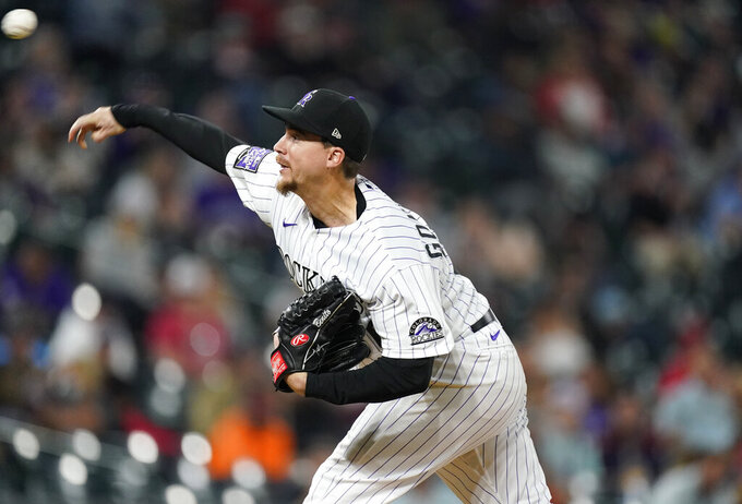 Colorado Rockies starting pitcher Chi Chi Gonzalez works against the Cincinnati Reds during  the sixth inning of a baseball game Thursday, May 13, 2021, in Denver. (AP Photo/David Zalubowski)
