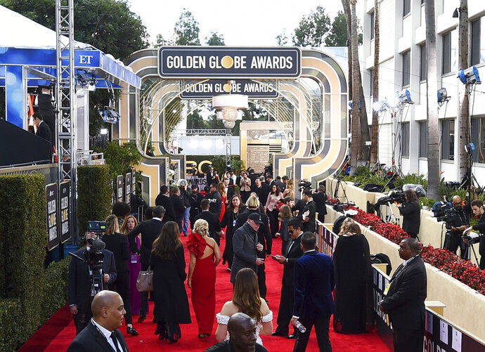 FILE - This Jan. 6, 2019 file photo shows members of the media on the red carpet prior to the 76th annual Golden Globe Awards  in Beverly Hills, Calif. The Hollywood Foreign Press Association (HFPA), dick clark productions (dcp) and NBC will present the 77th Annual Golden Globe Awards on Jan. 5, 2020. (Photo by Jordan Strauss/Invision/AP, File)