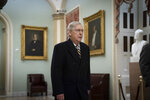 Senate Majority Leader Mitch McConnell, R-Ky., arrives as defense arguments by the Republicans resume in the impeachment trial of President Donald Trump on charges of abuse of power and obstruction of Congress, at the Capitol in Washington, Monday, Jan. 27, 2020. The stakes over witness testimony at President Donald Trump's impeachment trial are rising now that a draft of a book from former national security adviser John Bolton appears to undercut a key defense argument. (AP Photo/J. Scott Applewhite)