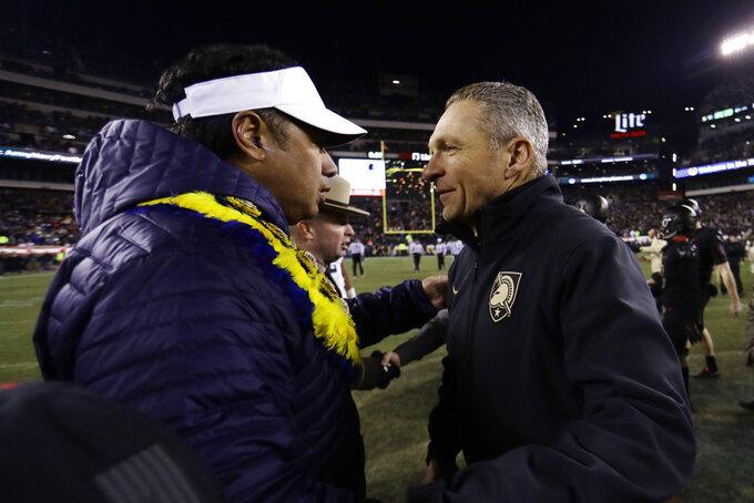 Army head coach Jeff Monken, right, greets Navy head coach Ken Niumatalolo after an NCAA college football game, Saturday, Dec. 8, 2018, in Philadelphia. Army won 17-10. (AP Photo/Matt Slocum)