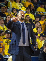 Michigan head coach Juwan Howard directs his players from courtside in the second half of an NCAA college basketball game against Presbyterian at Crisler Center in Ann Arbor, Mich., Saturday, Dec. 21, 2019. Michigan won 86-44. (AP Photo/Tony Ding)