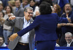 Connecticut head coach Geno Auriemma, left, and Buffalo head coach Felisha Legette-Jack embrace at the start of a second-round women's college basketball game in the NCAA tournament, Sunday, March 24, 2019, in Storrs, Conn. (AP Photo/Jessica Hill)
