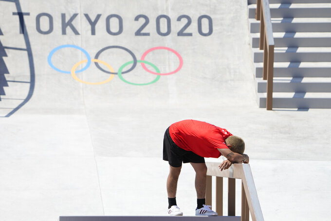 Angelo Caro Narvaez of Peru reacts after his final attempt during the men's street skateboarding finals at the 2020 Summer Olympics, Sunday, July 25, 2021, in Tokyo, Japan. (AP Photo/Jae C. Hong)