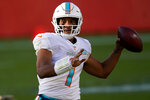 Miami Dolphins quarterback Tua Tagovailoa (1) looks to throw against the Denver Broncos during the first half of an NFL football game, Sunday, Nov. 22, 2020, in Denver. (AP Photo/David Zalubowski)