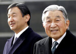 FILE - In this Jan. 26, 2016, file photo, Japan's Emperor Akihito, right, and Crown Prince Naruhito walk at Haneda international airport in Tokyo. Akihito has devoted his 30-year reign to making amends for a war fought in his father's name, while adapting the 1,500-year-old monarchy to draw the Imperial Family closer to the public. Akihito's Heisei era will end when he abdicates on April 30, 2019 in favor of his elder son, 58-year-old Naruhito, beginning a new, as yet unnamed era. (AP Photo/Eugene Hoshiko, File)