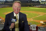 FILE - In this July 3, 2002, file photo, Los Angeles Dodgers television play-by-play announcer Vin Scully rehearses before a baseball game between the Dodgers and the Arizona Diamondbacks in Phoenix. To baseball fans, opening day is an annual rite of spring that evokes great anticipation and warm memories. This year's season was scheduled to begin Thursday, March 26, 2020, but there will be no games for a while because of the coronavirus outbreak. (AP Photo/Paul Connors, File)