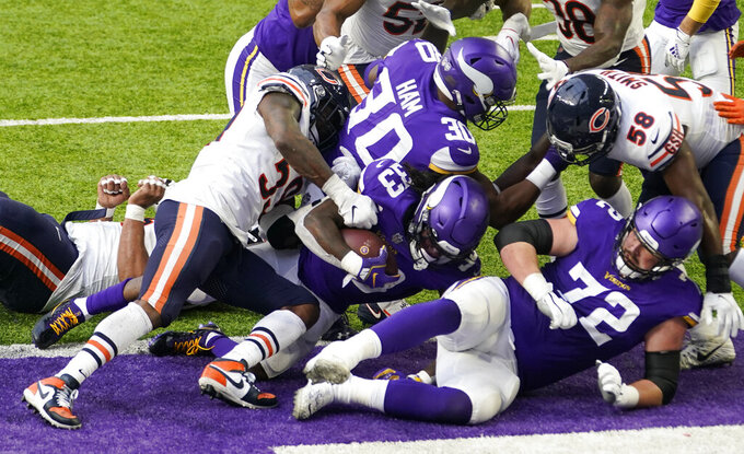 Minnesota Vikings running back Dalvin Cook (33) scores on a 1-yard touchdown run during the second half of an NFL football game against the Chicago Bears, Sunday, Dec. 20, 2020, in Minneapolis. (AP Photo/Jim Mone)