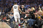 Wake Forest's guard Andrien White (13) slaps hands with fans court side after scoring against North Carolina in the first half of an NCAA college basketball game Tuesday, Feb. 11, 2020 in Winston-Salem, N.C. (AP Photo/Lynn Hey)