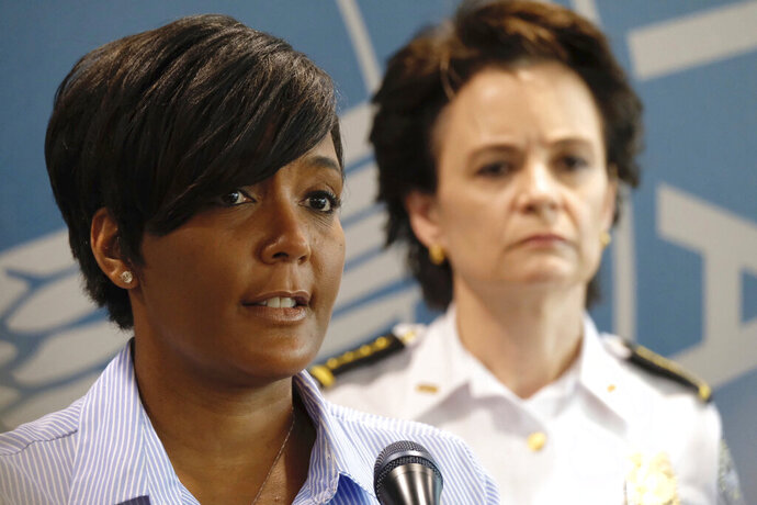 Inn this May 30, 2020, photo, Atlanta Mayor Keisha Lance Bottoms announces a 9 p.m. curfew as protests continue over the death of George Floyd. As the coronavirus and protests against police brutality have swept the nation, black female mayors including Atlanta's Keisha Lance Bottoms and Chicago's Lori Lightfoot have led the charge. (Ben Gray/Atlanta Journal-Constitution via AP)
