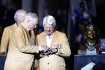 Dallas Cowboys team owner Jerry Jones honors former coach Jimmy Johnson for his Hall Of Fame induction during a halftime ceremony of an NFL football game between the Philadelphia Eagles and Dallas Cowboys in Arlington, Texas, Monday, Sept. 27, 2021. (AP Photo/Ron Jenkins)