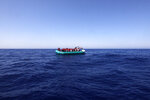 African migrants on a rubber boat in the Mediterranean Sea, off Libya are rescued by the MV Geo Barents vessel of MSF (Doctors Without Borders), in the central Mediterranean route, Monday, Sept. 20, 2021. (AP Photo/Ahmed Hatem)