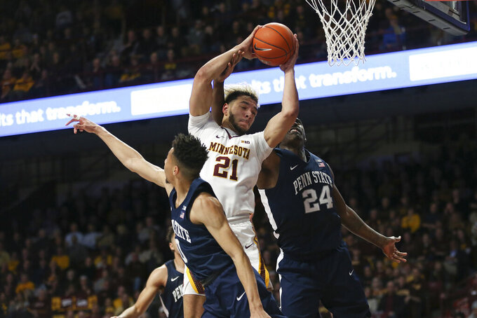 Minnesota's Jarvis Omersa goes up for a rebound against Penn State's Mike Watkins during an NCAA basketball game Wednesday, Jan. 15, 2020, in Minneapolis. (AP Photo/Stacy Bengs)