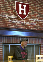 "FILE - In this Saturday, Oct. 29, 2016, file photo, basketball Hall of Famer Kareem Abdul-Jabbar speaks at Harvard in Cambridge, Mass. When George Floyd died in spring 2020, under a policeman's knee, Harvard basketball coach Tommy Amaker knew it was time to get to work. ""He wants the team to reflect Harvard's best efforts to show diversity,"" said Abdul-Jabbar, who spoke to the team in 2016. (AP Photo/Jimmy Golen, File)"