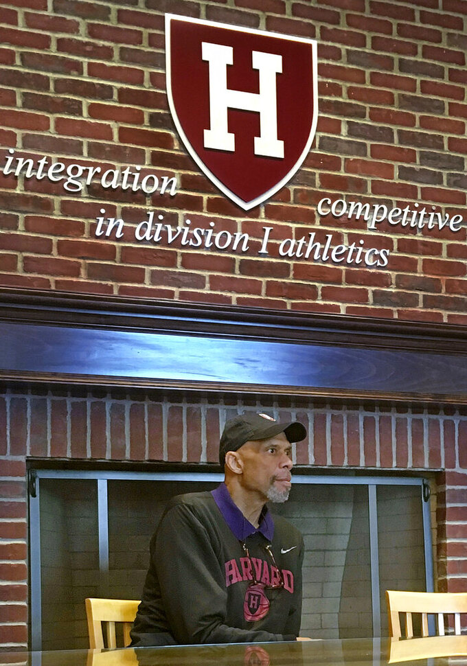 """FILE - In this Saturday, Oct. 29, 2016, file photo, basketball Hall of Famer Kareem Abdul-Jabbar speaks at Harvard in Cambridge, Mass. When George Floyd died in spring 2020, under a policeman's knee, Harvard basketball coach Tommy Amaker knew it was time to get to work. """"He wants the team to reflect Harvard's best efforts to show diversity,"""" said Abdul-Jabbar, who spoke to the team in 2016. (AP Photo/Jimmy Golen, File)"""
