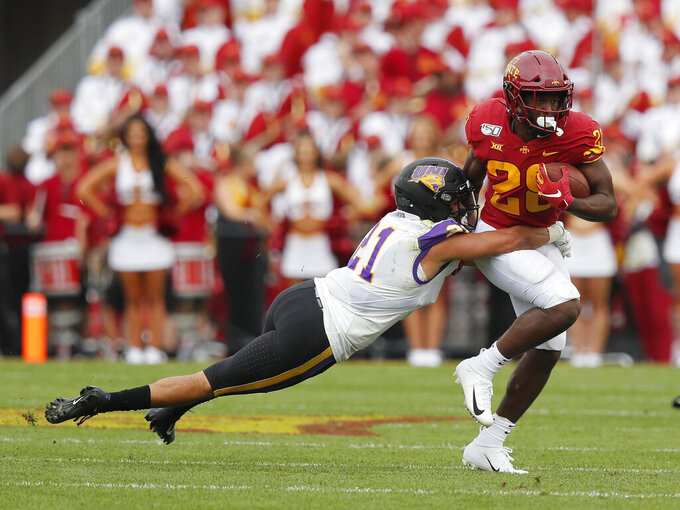 Iowa State running back Breece Hall, right, runs the ball as he is tackled by Northern Iowa defensive back Christian Jegen during the first half of an NCAA college football game, Saturday, Aug. 31, 2019, in Ames. (AP Photo/Matthew Putney)